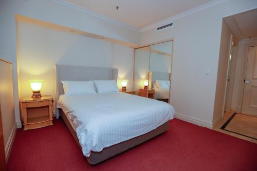 A bed or beds in a room at Bond 1409