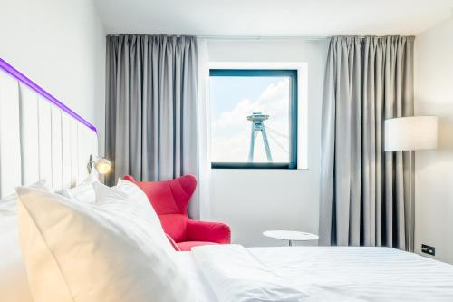 A bed or beds in a room at Park Inn by Radisson Danube Bratislava