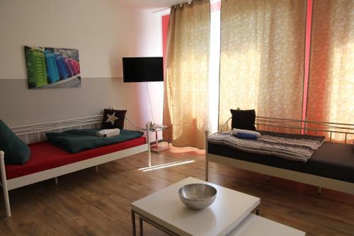Ein Bett oder Betten in einem Zimmer der Unterkunft Apartments Schlafoase Iserlohn