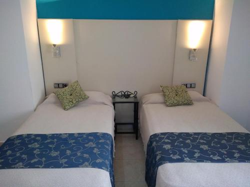 A bed or beds in a room at Hotel Nuevo Ara