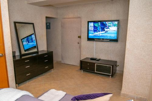 A television and/or entertainment center at Modern Unique Space in San Juan- Great Location!!!