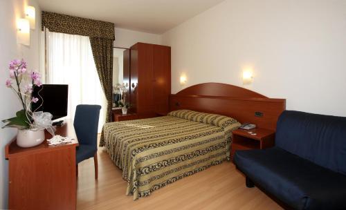 Postel nebo postele na pokoji v ubytování Hotel Santiago
