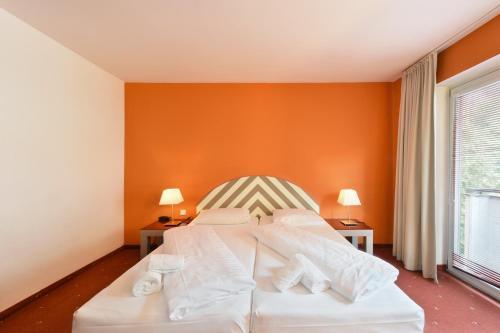 Ein Bett oder Betten in einem Zimmer der Unterkunft Hotel Neutor Express