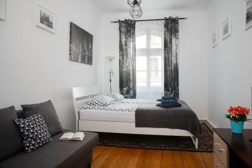 Łóżko lub łóżka w pokoju w obiekcie Flowers Apart Długa 19