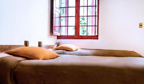 Cama o camas de una habitación en Bunkie Hostel