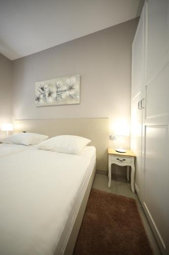 A bed or beds in a room at Teatro Verdi Accommodation
