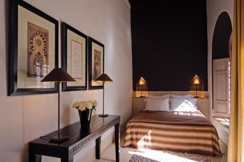 Un ou plusieurs lits dans un hébergement de l'établissement Riad Tzarra