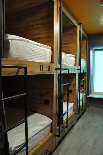 A bunk bed or bunk beds in a room at Full House Hotel & Capsule Hostel, Rivne