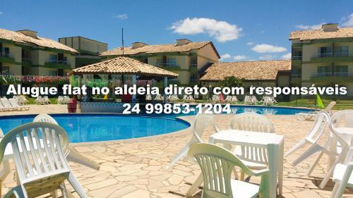 A piscina localizada em Flats no Aldeia das Águas ou nos arredores