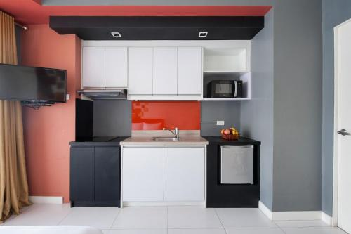 A kitchen or kitchenette at KL Serviced Residences Managed by HII