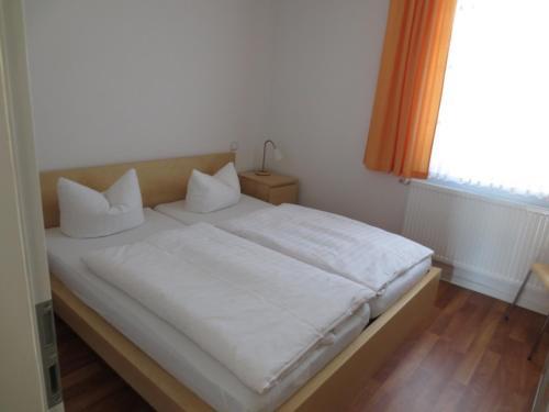 Ein Bett oder Betten in einem Zimmer der Unterkunft Zur Wildgans