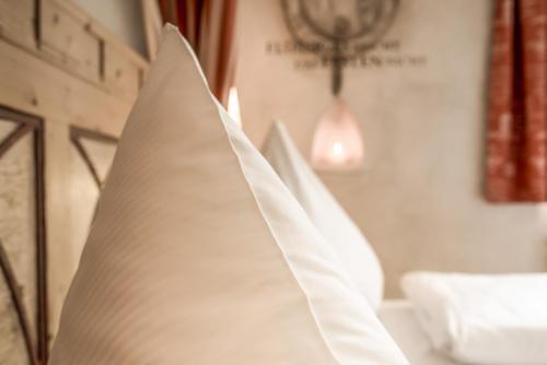 Ein Bett oder Betten in einem Zimmer der Unterkunft Hotel Arthus