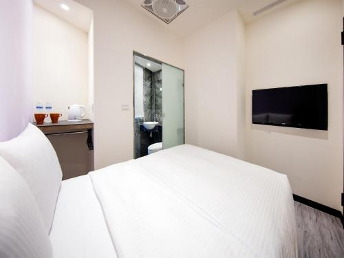 A bed or beds in a room at Tianxiang Zan Apartment