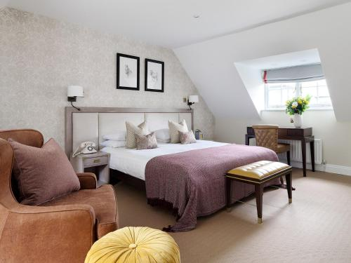 A bed or beds in a room at Eastwell Manor, Champneys Hotel & Spa