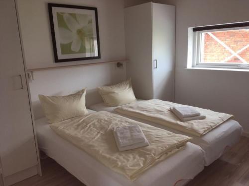 Postel nebo postele na pokoji v ubytování Ferienhaus Ostseeperle