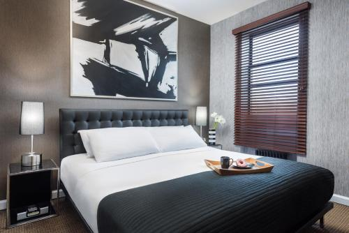 A bed or beds in a room at Park West Hotel