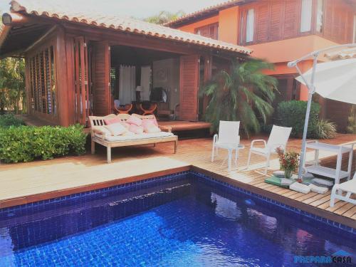 The swimming pool at or near Casa de Férias na Praia em Costa do Sauípe