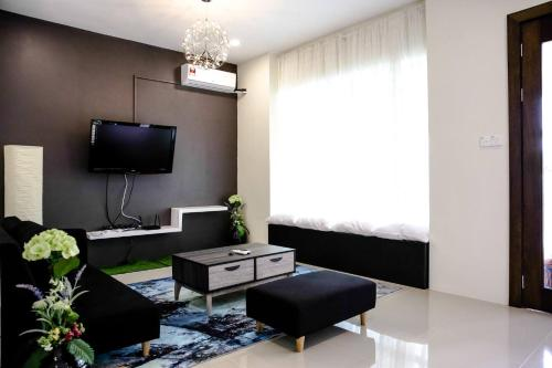 A television and/or entertainment centre at Sibu Swanhouse No.3