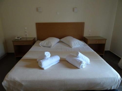 A bed or beds in a room at Alkistis Hotel