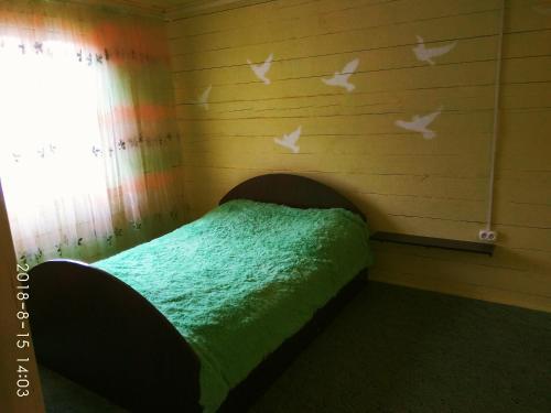 Кровать или кровати в номере Загородный дом