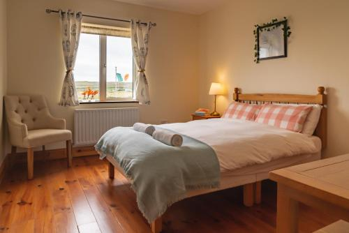 A bed or beds in a room at Aran Walkers Lodge