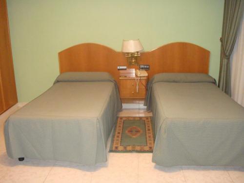 Cama o camas de una habitación en Hostal Serpol