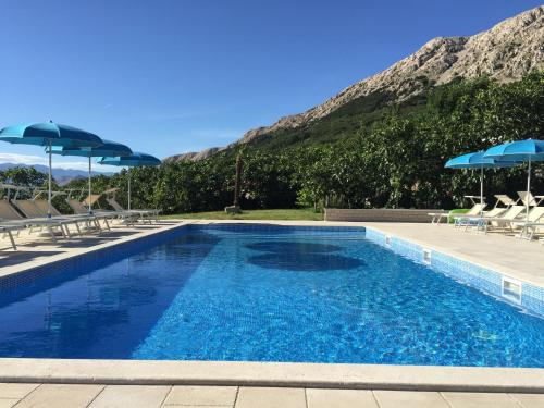 The swimming pool at or close to Apartments Juranić