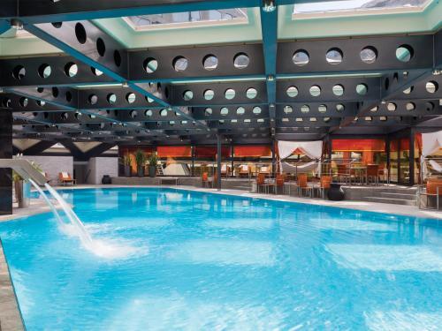 The swimming pool at or near Fairmont Grand Hotel Geneva