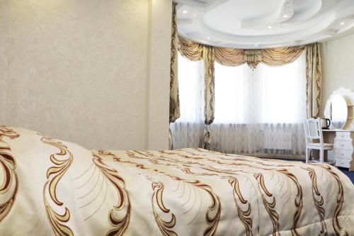 Кровать или кровати в номере Лагуна Янтарная