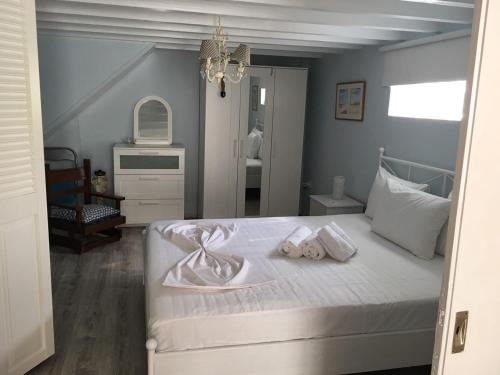A bed or beds in a room at Aphrodite Boutique Hotel