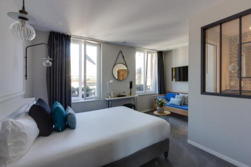 A bed or beds in a room at Les 2 Villas