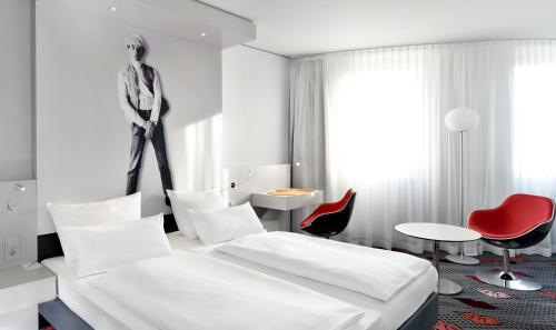A bed or beds in a room at art'otel berlin kudamm