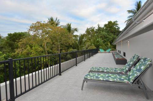 A balcony or terrace at The Port Douglas Beach House