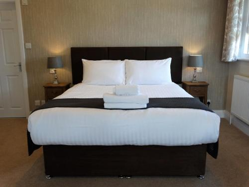 A bed or beds in a room at Cantley House Hotel - A Bespoke Hotel