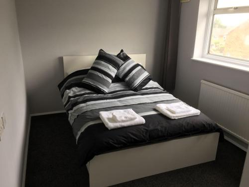 A bed or beds in a room at Fairview
