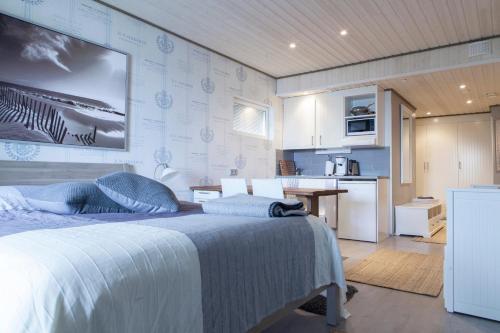 Vuode tai vuoteita majoituspaikassa Villa Seaview Guesthouse & Spa