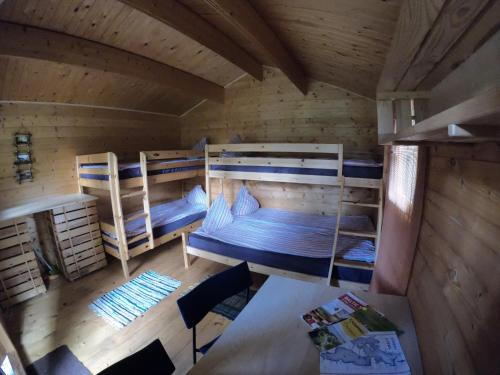 A bunk bed or bunk beds in a room at Bukdangas