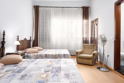 A bed or beds in a room at Almada Guest House