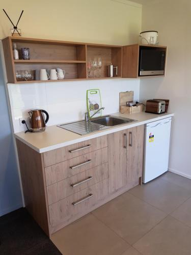 A kitchen or kitchenette at Murchison View Studio