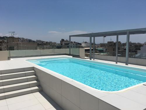 The swimming pool at or near Piraeus Theoxenia Hotel