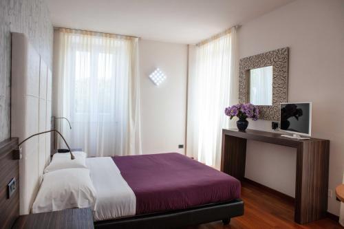 Postel nebo postele na pokoji v ubytování Hotel Vittorio