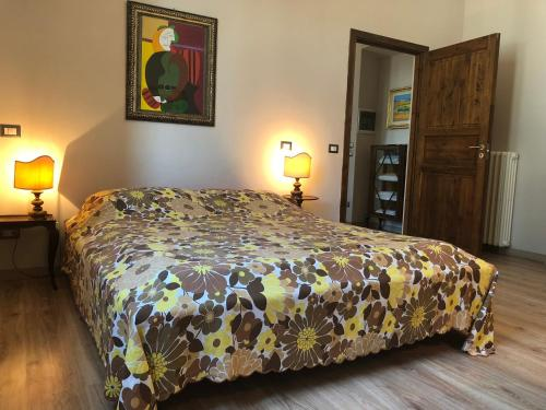 A bed or beds in a room at Appartamento Vittoria