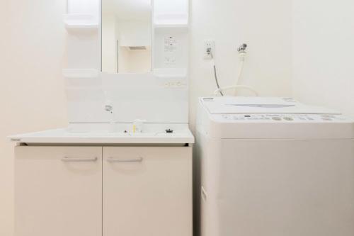 A bathroom at Ostay Osaka-jo Hotel Apartment