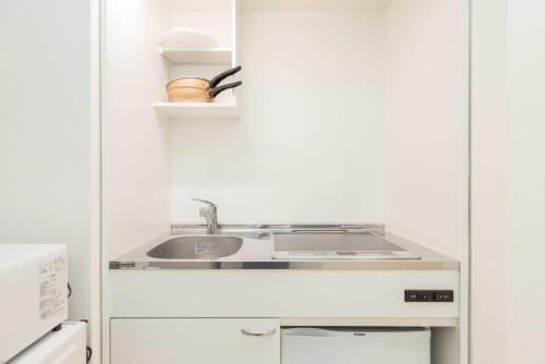 A kitchen or kitchenette at Ostay Osaka-jo Hotel Apartment
