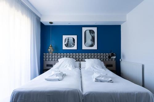 A bed or beds in a room at La Concha Soul Boutique Hotel