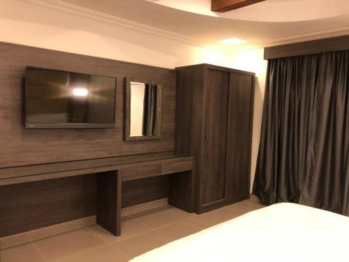 تلفاز و/أو أجهزة ترفيهية في فيلا للأجنحة الفندقية