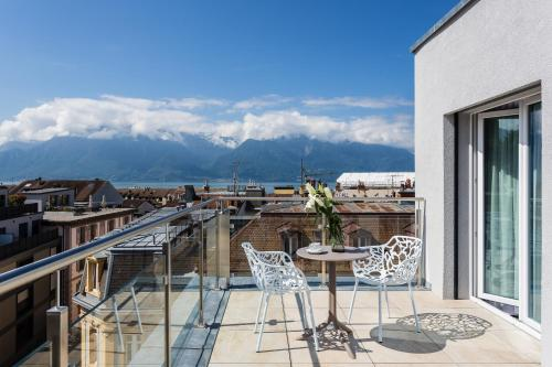 A balcony or terrace at VISIONAPARTMENTS Rue des Communaux - contactless check-in