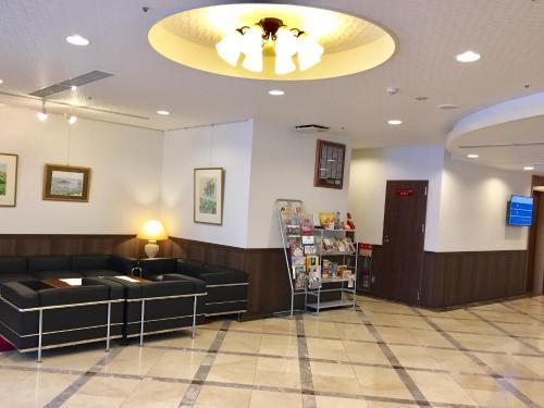 Area lobi atau resepsionis di Sunwest Hotel Sasebo