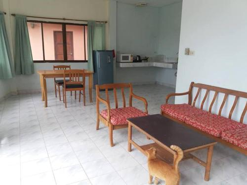 A seating area at Orange house on the hill Kata