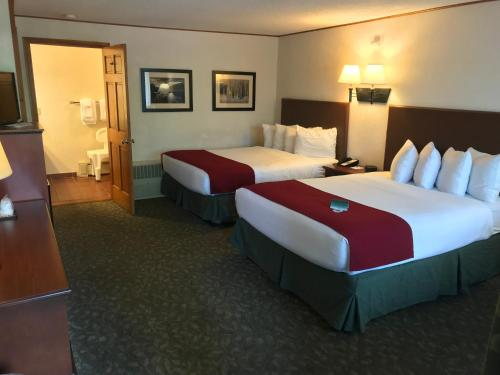 A bed or beds in a room at Best Western Adirondack Inn